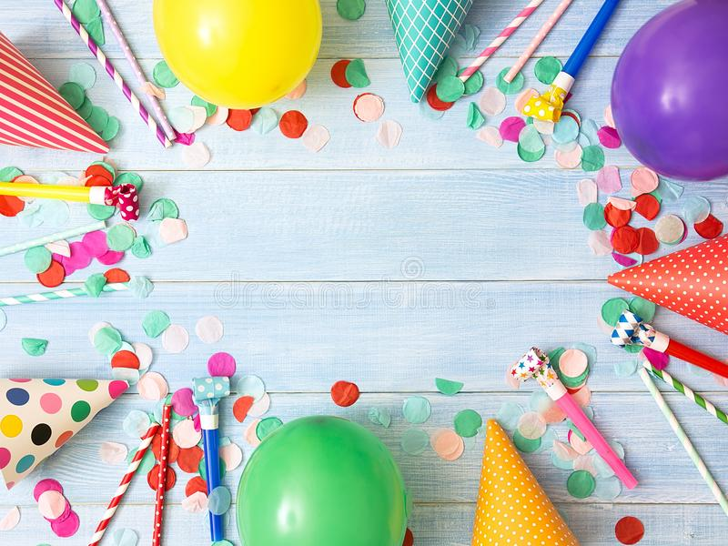 Birthday or party background. Holiday frame or background with colorful balloon, confetti, carnival cap and streamer. Flat lay style. Birthday or party greeting royalty free stock photography