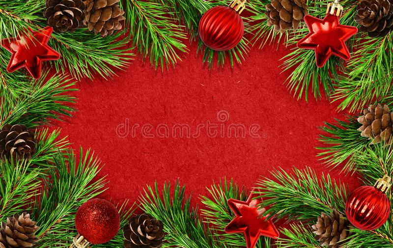 Holiday frame with Christmas tree twigs, cones and balls royalty free stock photos