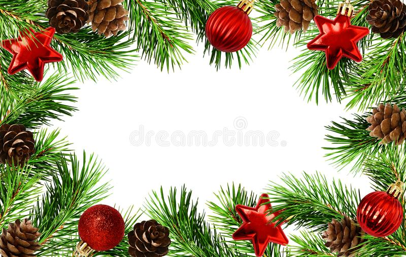 Holiday frame with Christmas tree twigs, cones, and balls stock photos