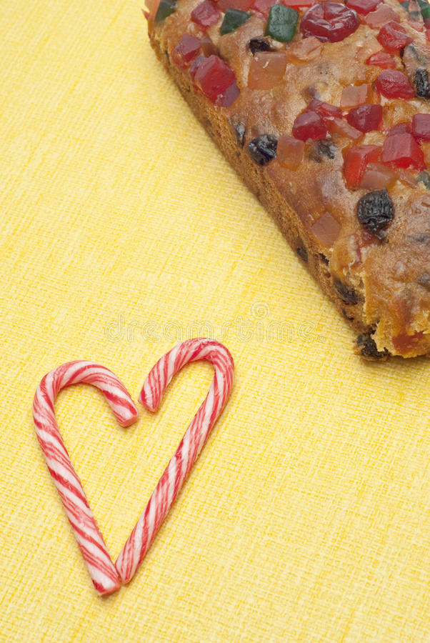 Holiday Fruit Cake with Candy Cane Candies stock photos