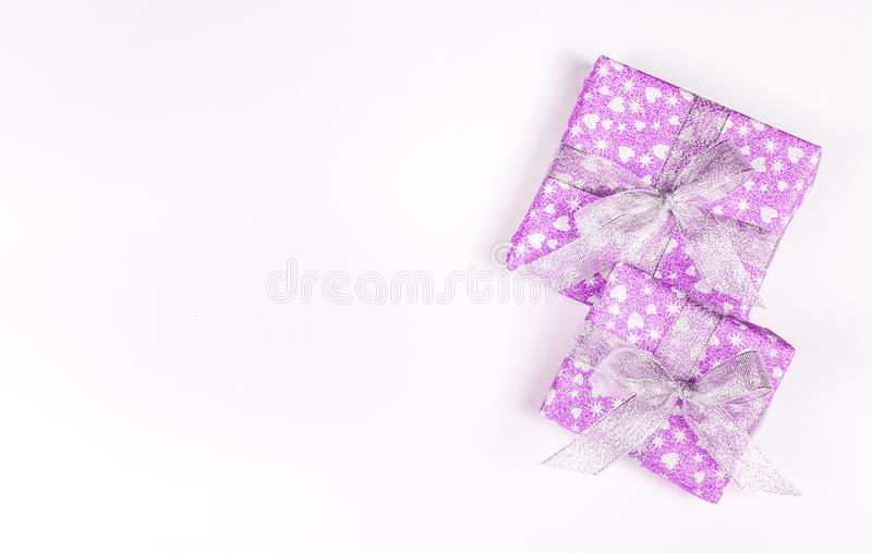 Holiday gift boxes with bows and hearts. St. Valentine`s Day. Brilliant boxes. royalty free stock image
