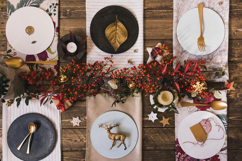 Holiday Gold place setting, funny Christmas table with ornaments royalty free stock photo