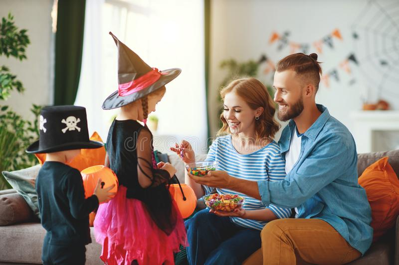 Holiday  Halloween. children ask their parents for candy in costumes. Holiday of Halloween. children ask their parents for candy in costumes stock images