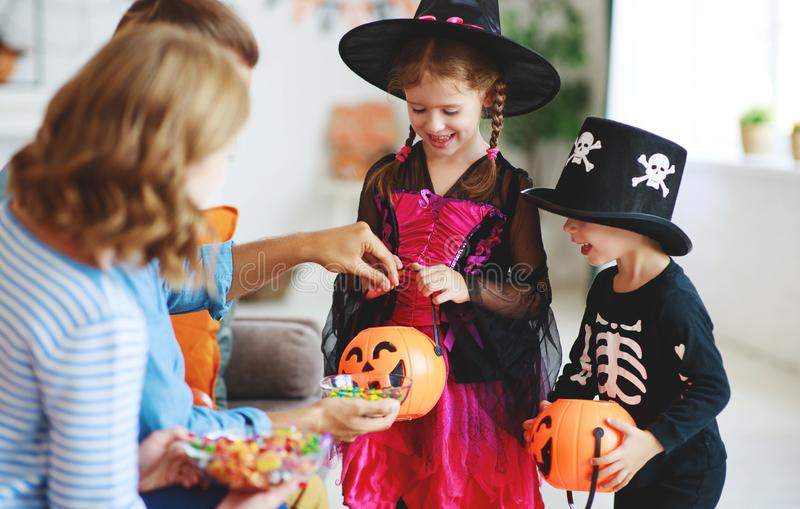 Holiday  Halloween. children ask their parents for candy in costumes royalty free stock photography