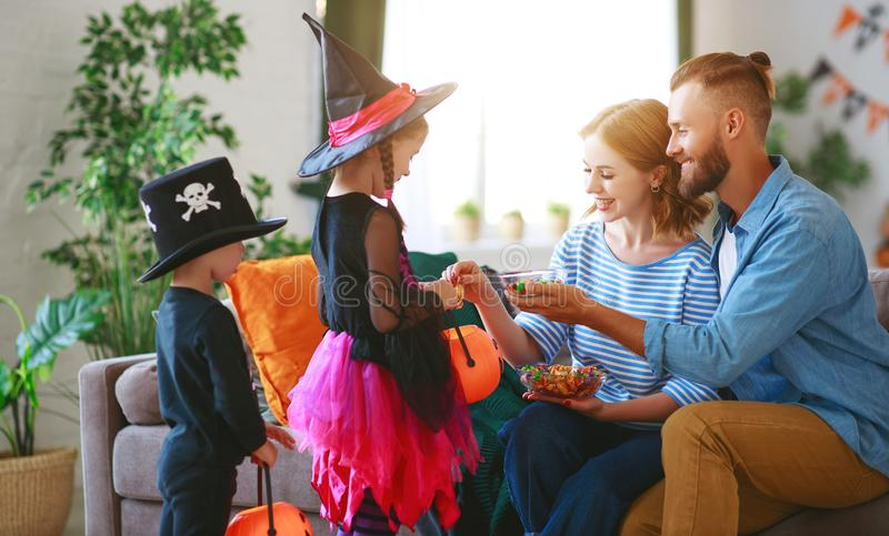 Holiday  Halloween. children ask their parents for candy in costumes stock photos