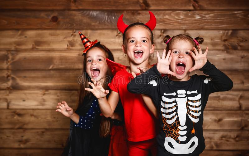 Holiday halloween. Funny group children in carnival costumes royalty free stock photography