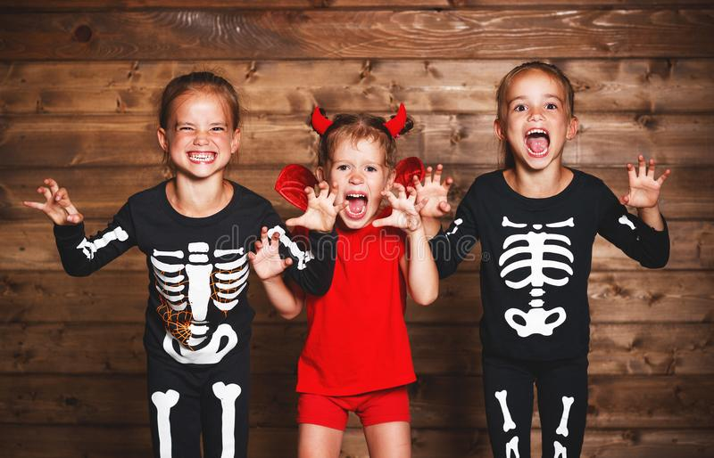 Holiday halloween. Funny group children in carnival costumes stock photos