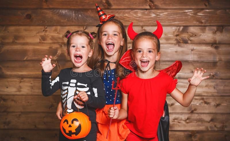 Holiday halloween. Funny group children in carnival costumes stock photo