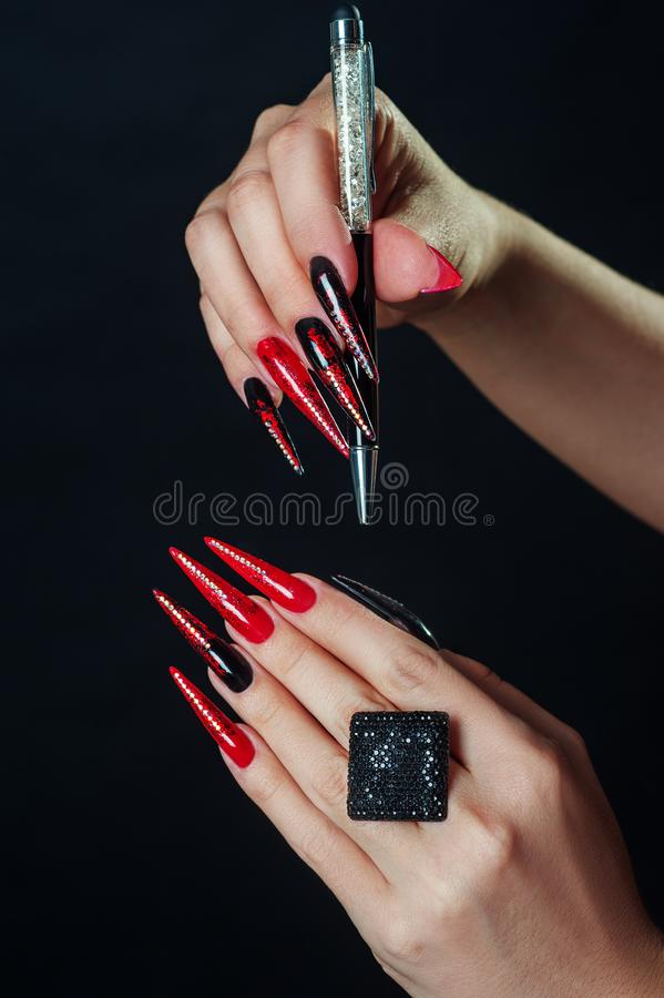 Holiday halloween or new year nail art design ideas. Beauty Fashion Hands Trendy Stylish Colorful manicure. Black Red fingers royalty free stock photography