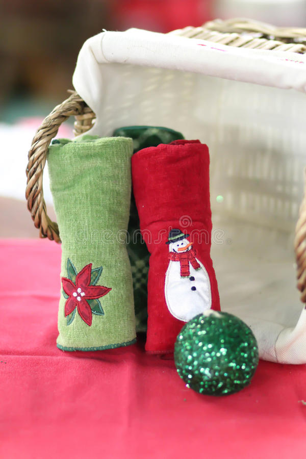 Holiday hand towels. On display in front of a lined basket royalty free stock photos
