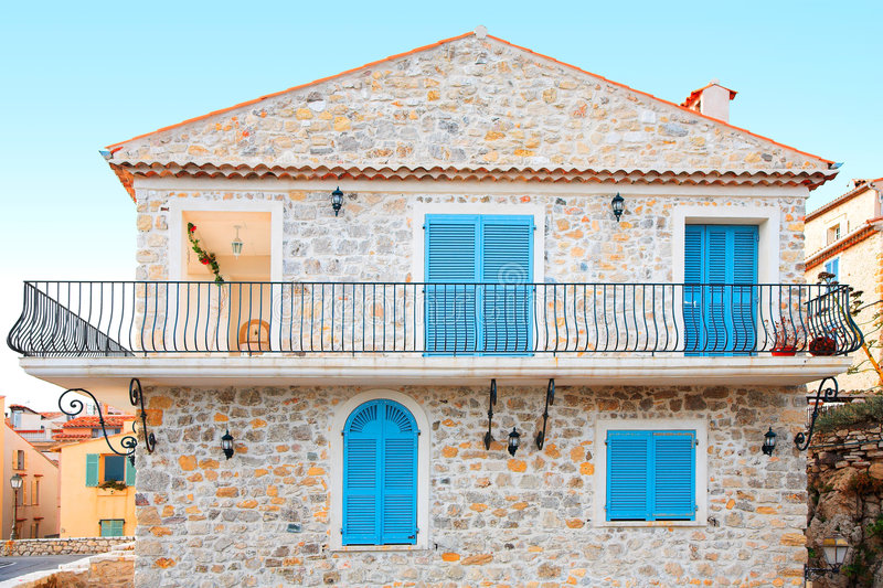 Holiday home in Antibes France. Pretty stone house with blue shutters and a balcony stock image