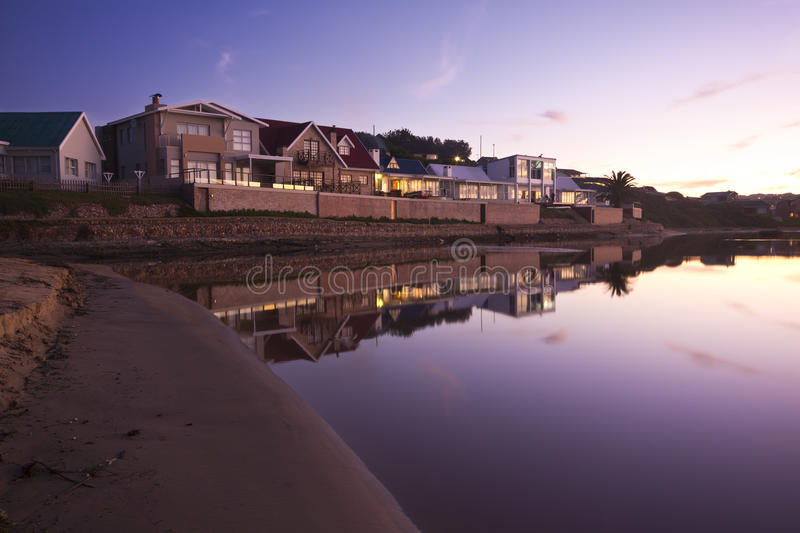 Download Holiday Homes Beside A Lagoon At Sunset Stock Photo - Image: 26084790