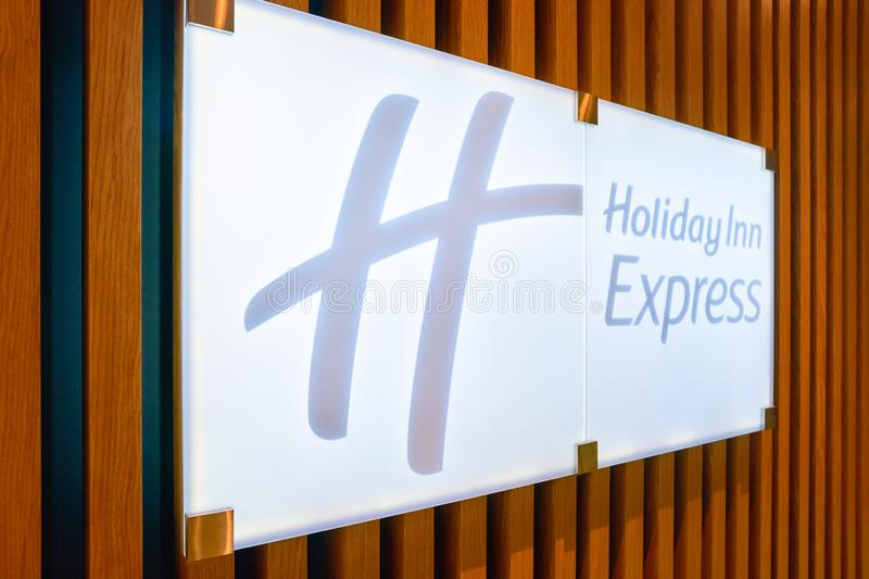 Holiday Inn Express. MOSCOW, RUSSIA - CIRCA AUGUST, 2018: close up shot of Holiday Inn Express sign. Holiday Inn Express is a mid-priced hotel chain within the royalty free stock photos