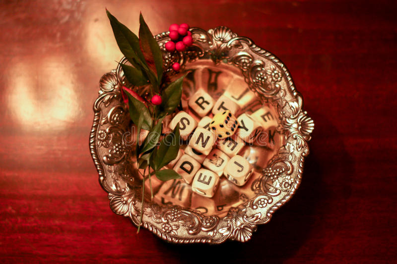 Holiday letters. Boggle dice in a festive dish stock photo