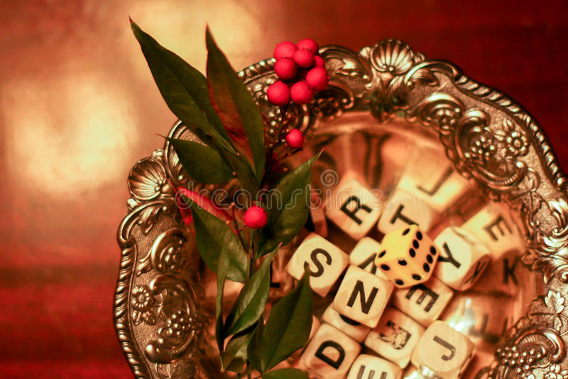 Holiday letters. Boggle dice in a festive dish stock photos