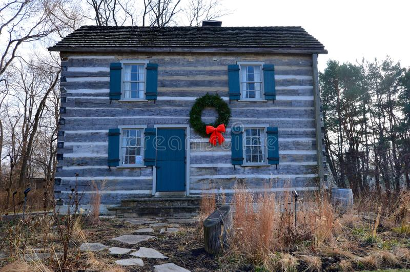 Holiday Log House. This is a picture of a log house in Winnetka, Illinois. This log house was built in 1836 and was the home of artist/author Anita Willets royalty free stock images