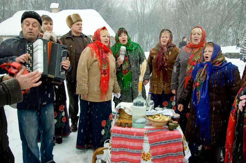 Holiday Maslenitsa. KIEV - February 14: Folk Ukrainian Group celebrating Russian religious and folk holiday Maslenitsa in the orthodox churches walking on the stock photo