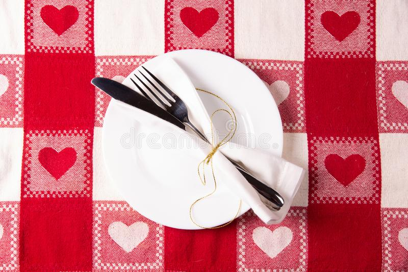 Holiday menu concept on the tablecloth with a heart pattern symbol stock photos