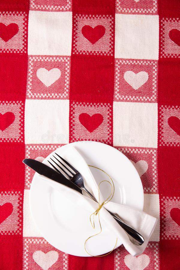 Holiday menu concept on the tablecloth with a heart pattern symbol stock image