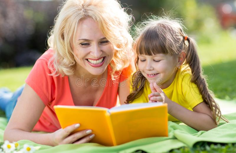 Holiday in nature. Mother and child daughter having fun on the lawn. royalty free stock photography
