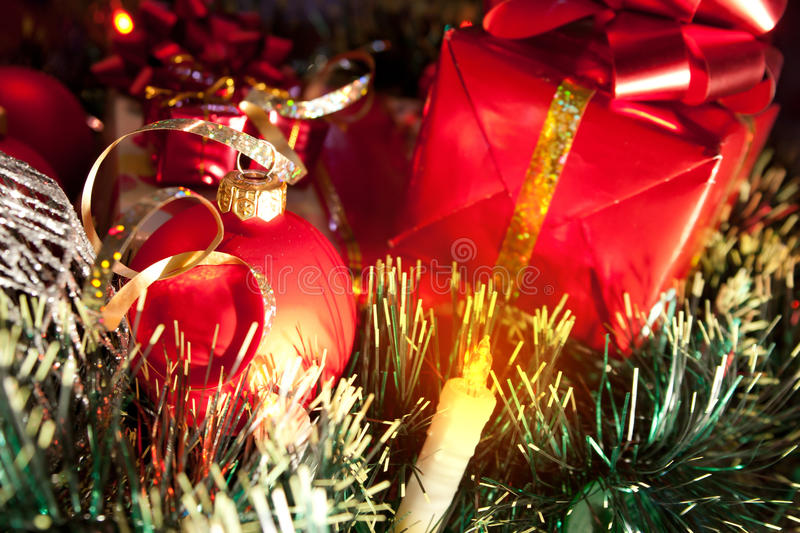 Holiday ornaments, gifts and candle stock image