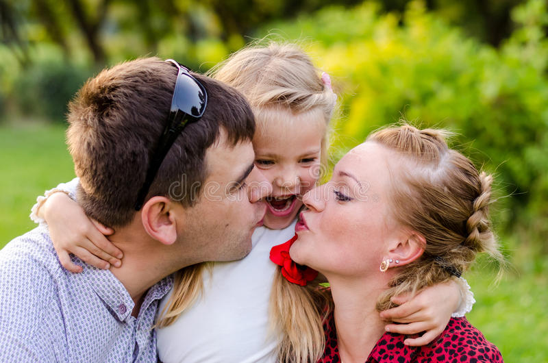Holiday outdoor portrait of happy family hugging and laughing at the picnic stock photography