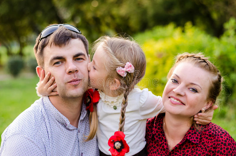 Holiday outdoor portrait of happy family hugging and laughing at the picnic stock images