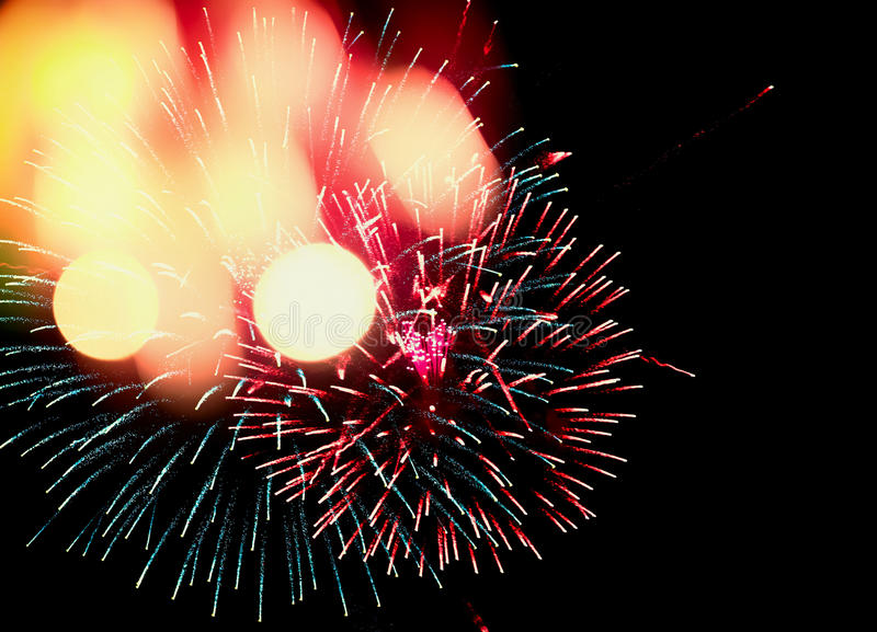 Holiday or party fireworks with festive bokeh on black sky background for the New Year royalty free stock photo