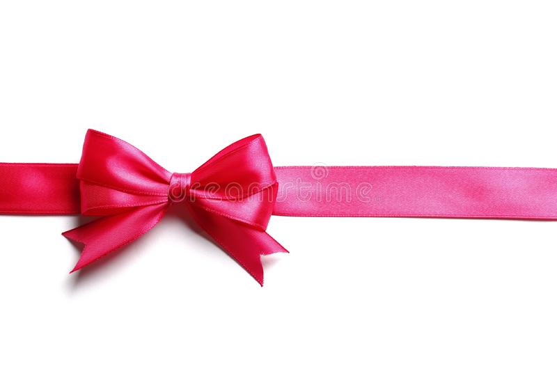 Pink bow and ribbon on a white background. Holiday Pink bow and ribbon isolated on a white background stock photos