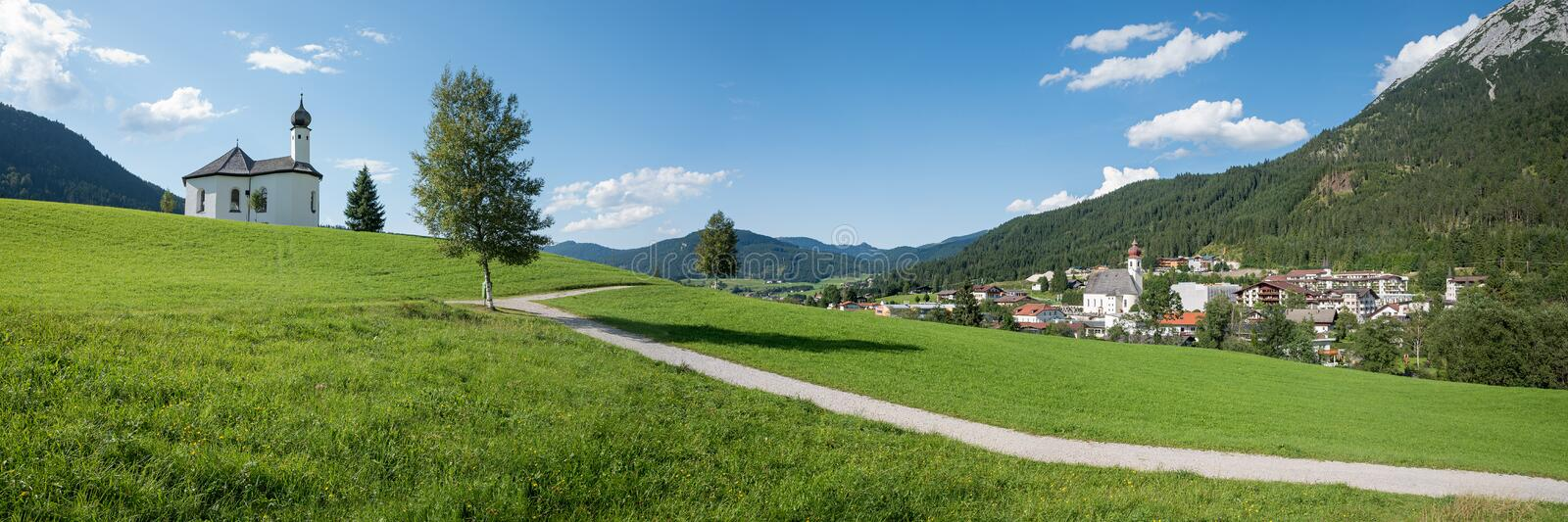 Holiday place achenkirch, sunny summer landscape austria. Panoramic view to beautiful holiday place achenkirch, sunny summer landscape austria with village and stock images