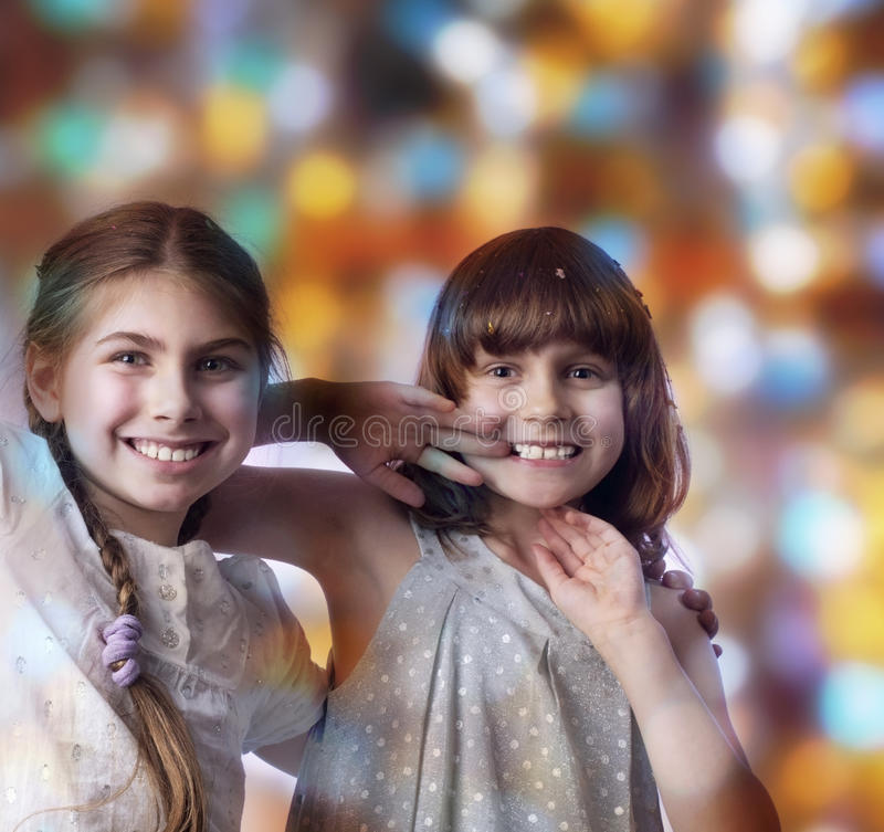 Holiday portrait of happy children against bright background stock photos