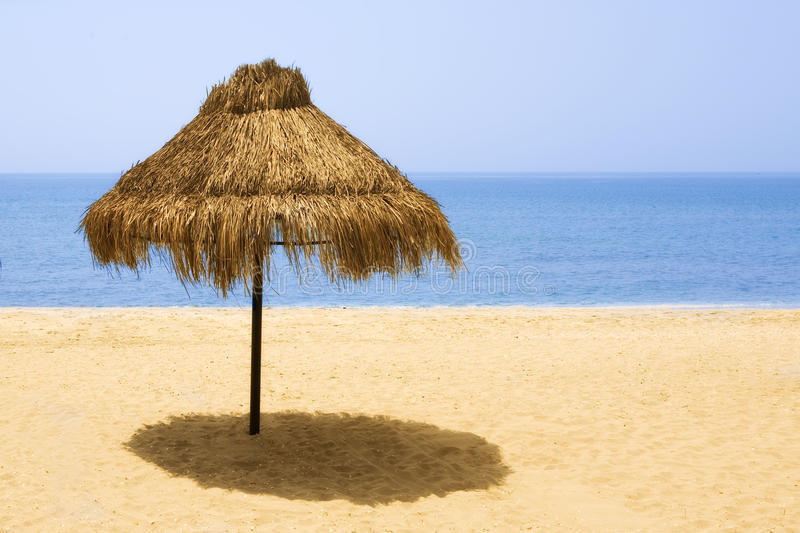 Holiday relaxing. Parasols on a beach in the morning (while nobody has come)Holiday relaxing stock photo