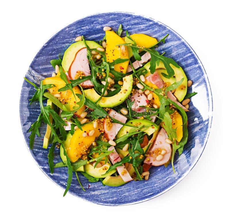 Holiday salad with smoked chicken, mango, avocado and arugula stock photography