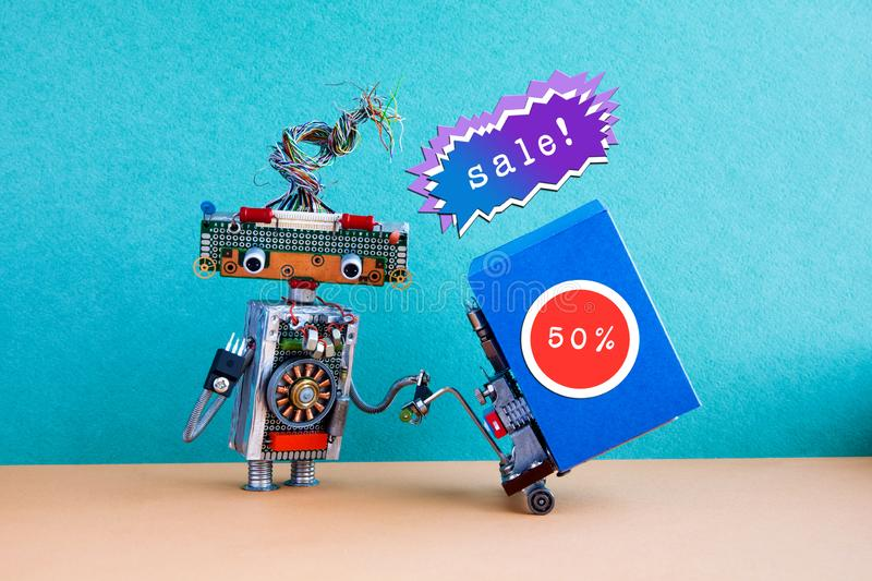 Holiday sales promotion poster. Funny robot moving shopping cart big blue box, 50 percent sale sticker. Holiday sales promotion poster. Funny robot moving royalty free stock photography