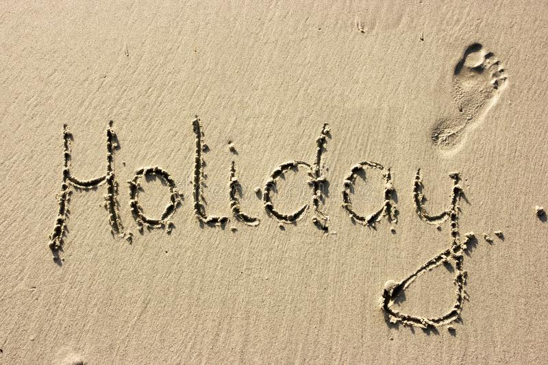 Holiday on sand stock images