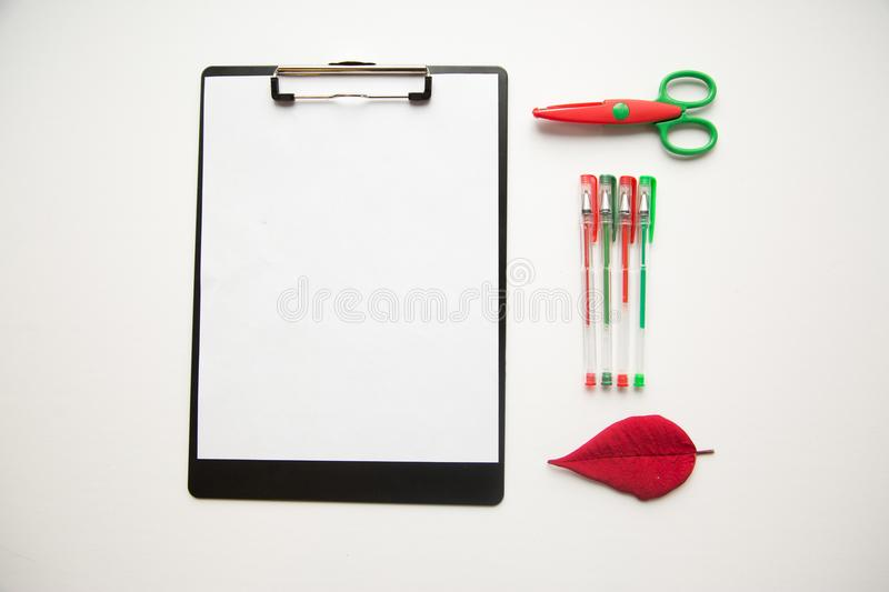 Holiday scissors and pens on white background stock images
