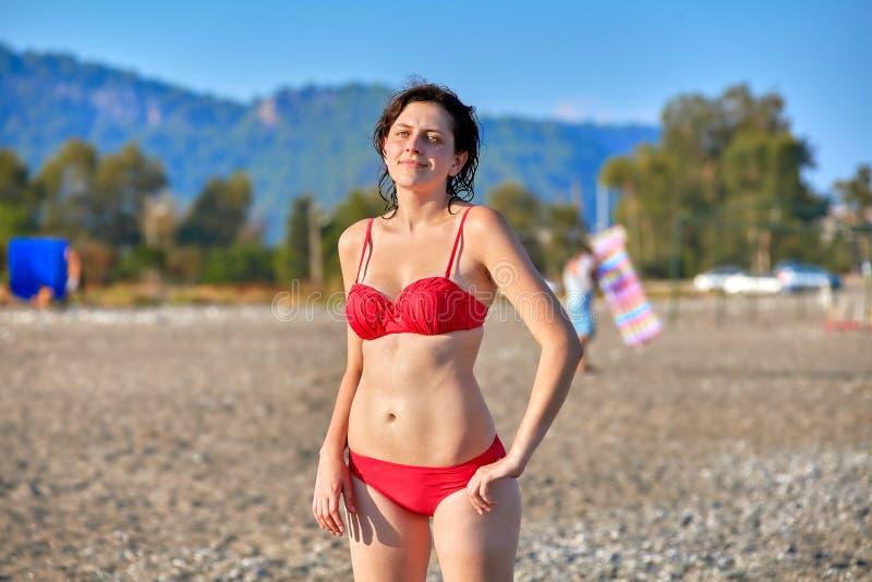 Woman sunbathes at sea tourist resort in summer stock image