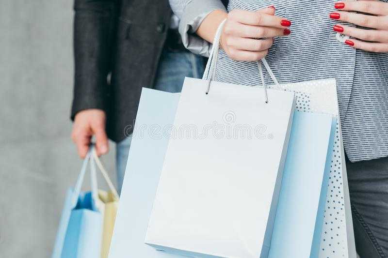 Holiday shopping gifts buying woman carrying bags royalty free stock photography