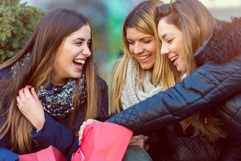 Holiday shopping girls in the street with bags. Group of girls in the street in the winter time shopping together royalty free stock photography