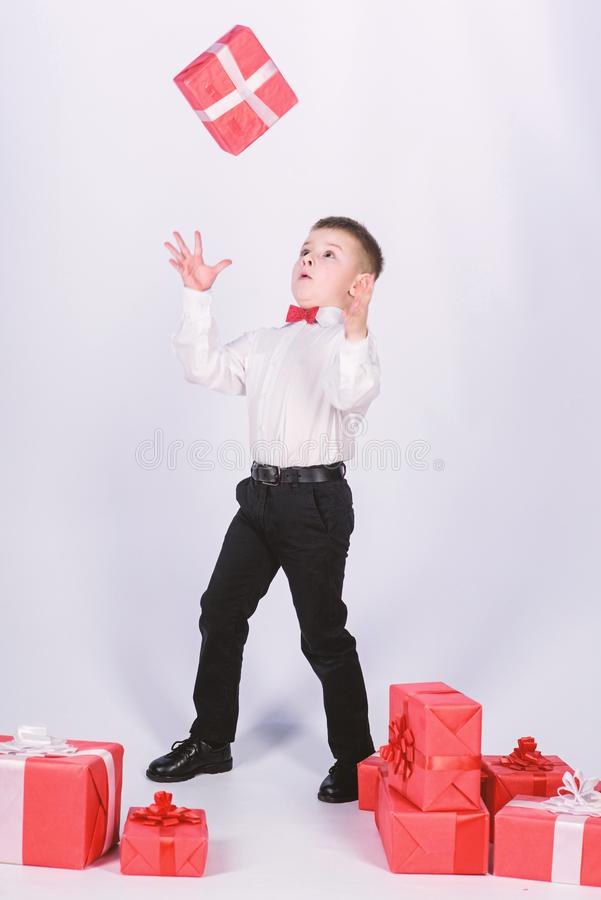 Holiday shopping seasonal sale. Celebrate new year valentines day. Birthday gift. Small boy hold gift box. Christmas or. Birthday gift. Dreams come true. Buy stock images