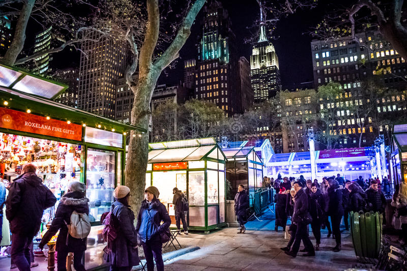 Holiday Shops Bryant Park. NEW YORK-DECEMBER 14: Holiday shoppers enjoy the scene of the Winter Village at Bryant Park on December 14, 2016 in Manhattan stock photography