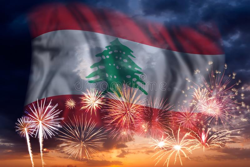 Fireworks and flag of Lebanon. Holiday sky with fireworks and flag of Lebanon, independence day royalty free stock photos