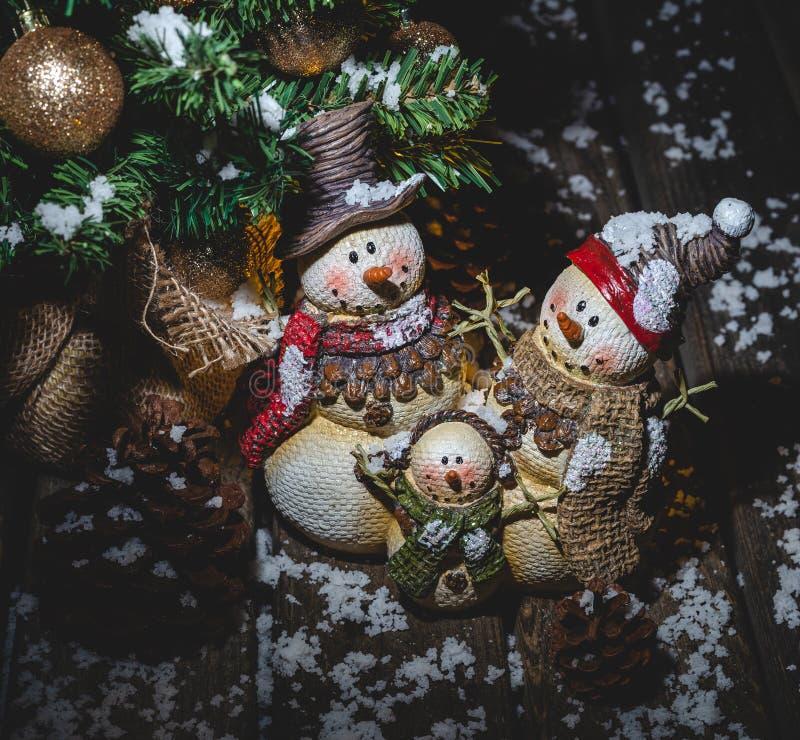 Holiday Snowmen Under Christmas Tree stock photos