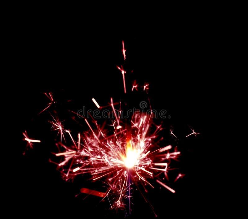 Holiday sparkler with smoke on dark. royalty free stock photos