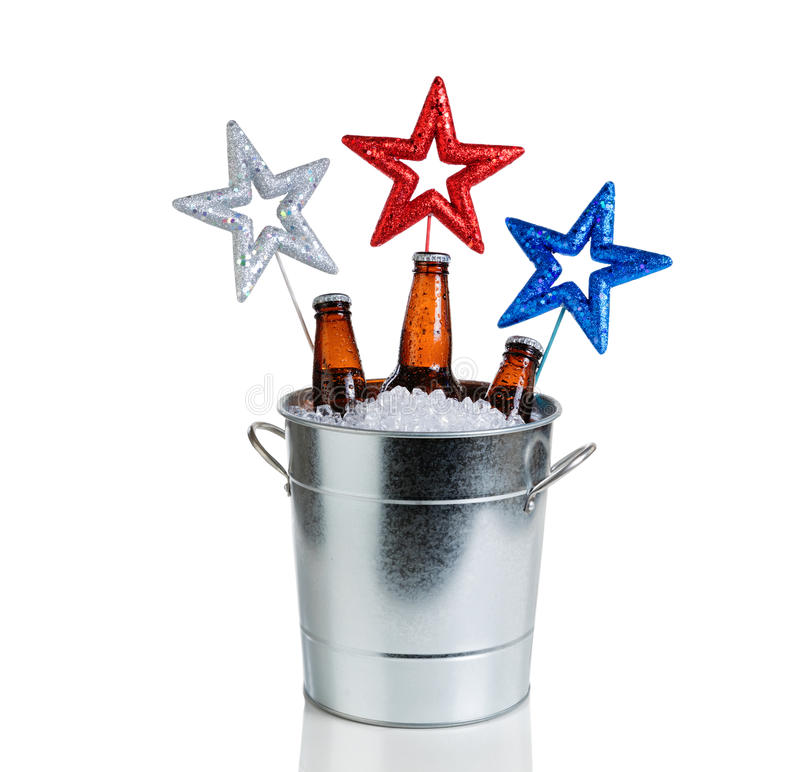 Holiday stars and bucket of ice and cold beer on white background royalty free stock photo