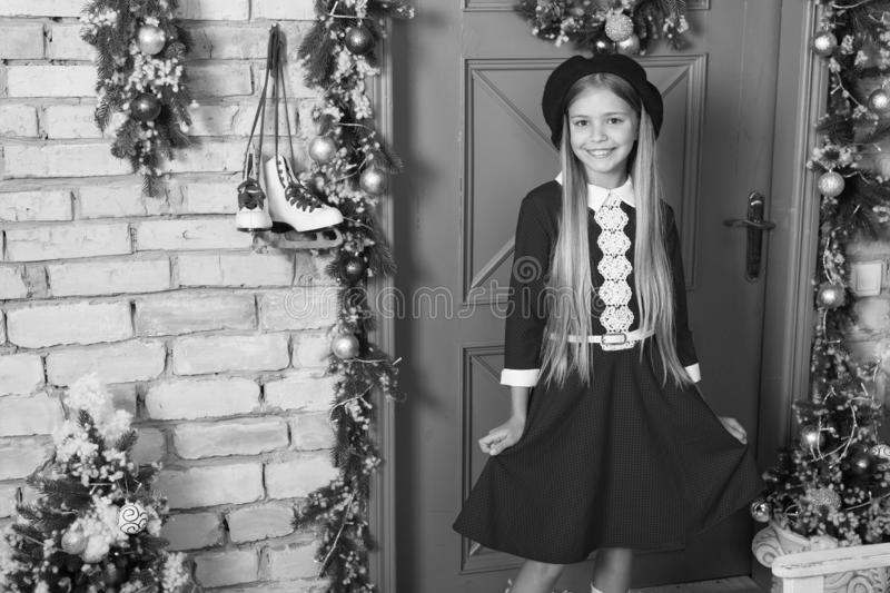 Holiday style inspiration. Fashion girl go to Christmas celebration. Little girl child in xmas dress. Fashionable small. Child. Small model with fashion look stock image
