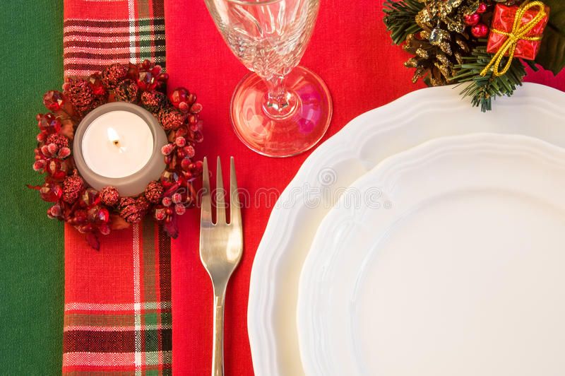 Holiday table with Christmas decorations and burning candle. stock photo