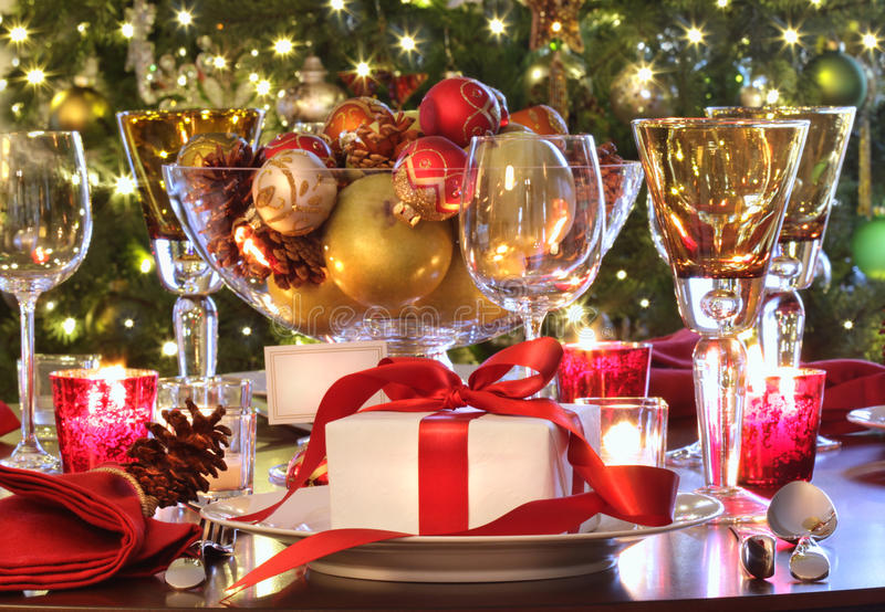 Holiday table setting with red ribbon gift