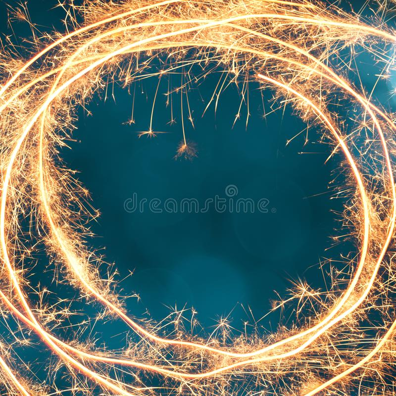 Holiday Template for design to christmas, new year, birthday. Beautiful Festive Background. Round frame of Sparkling sparkler on turquoise background. Holiday stock image