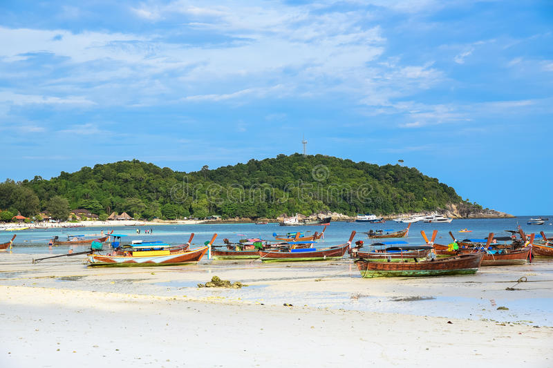 Holiday in Thailand - Beautiful Island of Koh Lipe with long tail boat by the beach at Satun, Thailand.  royalty free stock photos